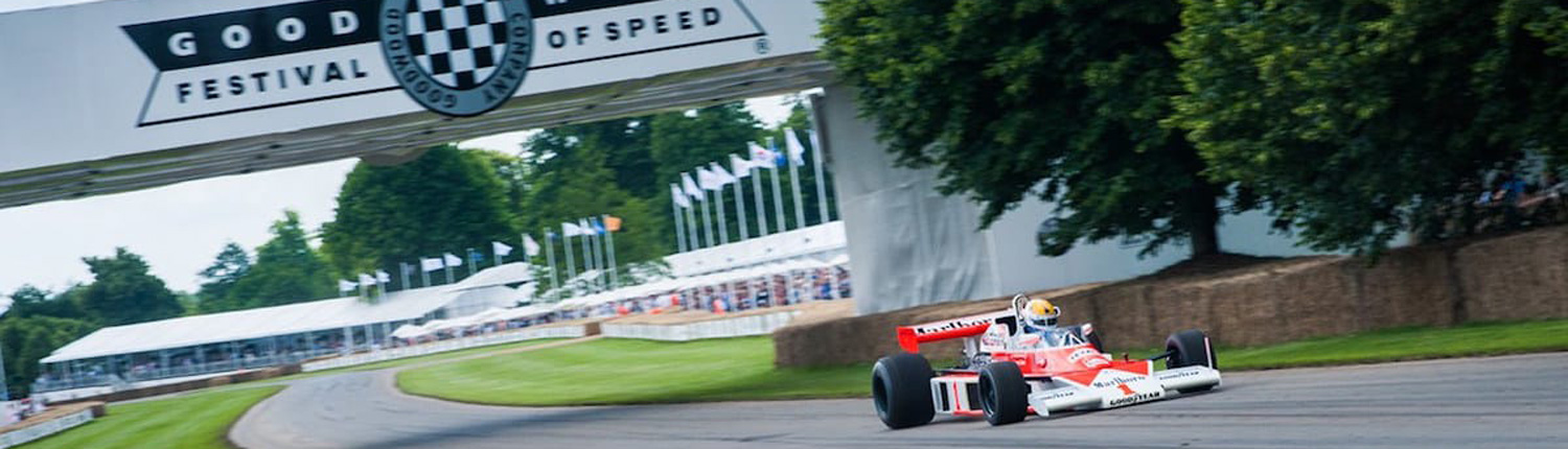 view of a racing car going around the goodwood race circuit at goodwood festival of speed